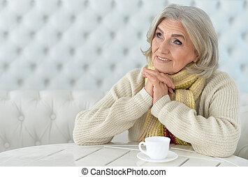 woman drinking coffee - Portrait of a woman drinking coffee,...