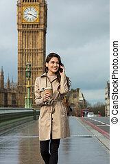 Woman Drinking Coffee Talking on Cell Phone, Big Ben, London, England