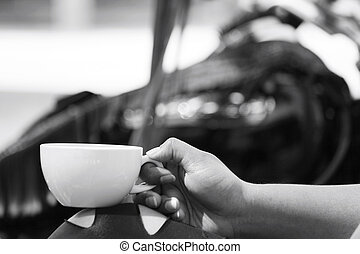 Woman drinking coffee with motorcycle