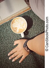 Woman drinking coffee with smartwatch