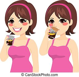 Beautiful young brunette caucasian woman drinking a glass of cola on two action