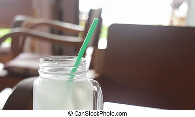Woman drinking fresh coconut water