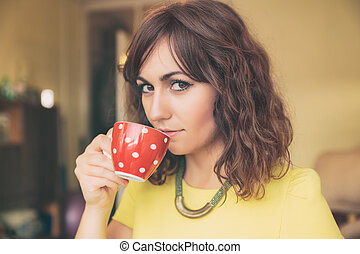 Woman Drinking from Red Polka Dot Tea Mug