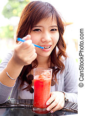 Woman drinking fruit shakes.