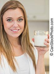 Woman drinking glass of milk