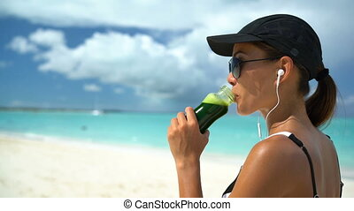 Woman Drinking Green Vegetable Smoothie On Beach - Healthy ...
