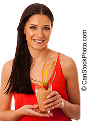 Woman drinking healthy fresh fruit smoothie decorated with red strawberry.