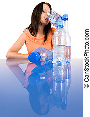 Woman drinking healthy mineral wate