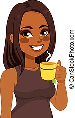 Beautiful young African American woman having herbal tea infusion