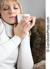 Woman drinking hot mug of coffee