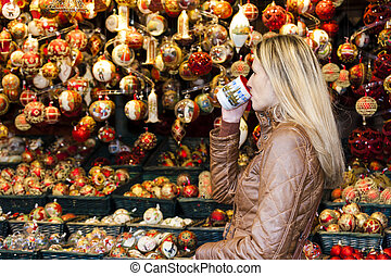 Elderly Couple Drinking Hot Drinks At Christmas Market Mature