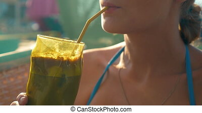 Woman Drinking Ice Coffee in Hot Day