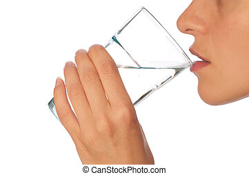 woman drinking mineral water from the glass
