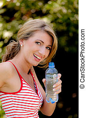 Woman drinking mineral water