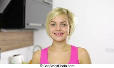 Woman drinking orange juice happy smile