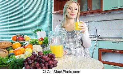woman drinking orange juice