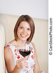 Woman drinking red wine in a restaurant