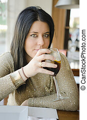 Woman drinking soda at restaurant