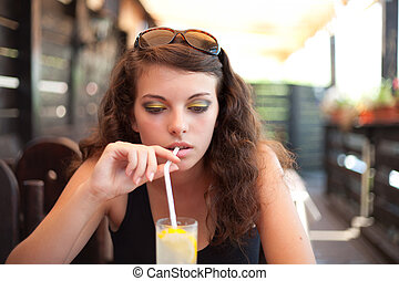 Woman drinking soda