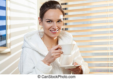 Woman drinking tea after treatment