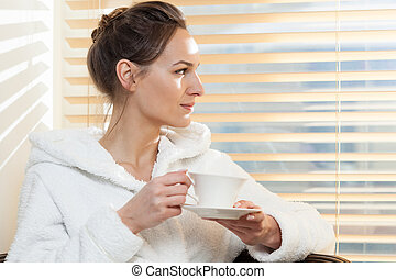 Woman drinking tea in spa