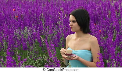 Woman drinking tea in the field - Beautiful girl drinking...