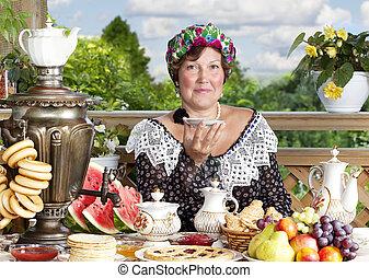 Woman drinking tea outdoors