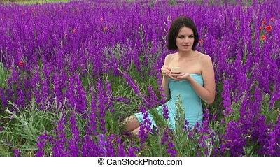 Woman drinking tea - Beautiful girl drinking tea in nature...