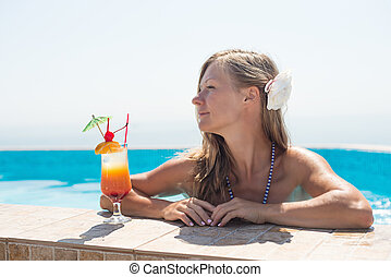 Woman drinking tropical cocktail