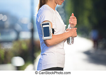 woman drinking  water after  jogging