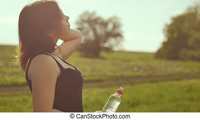 Woman drinking water after sport nature