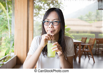 Woman drinking water from a glass.