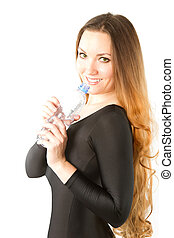 Woman drinking water from bottle after workout at gym on white isolated background.
