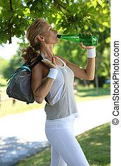 Woman drinking, water