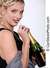 Woman drinking wine with a straw