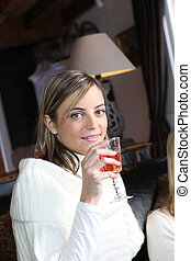 Woman drinking wine with friends