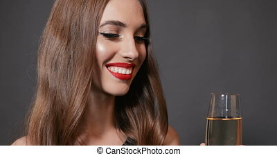 Woman Drinks Champagne at New Year Party - Gorgeous slender...