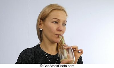 woman drinks detox smoothie, healthy lifestyle concept. cocktail from vegetable and fruit. slow motion