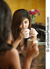 Woman Drinks from a Mug