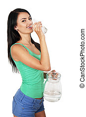 woman drinks water from a glass