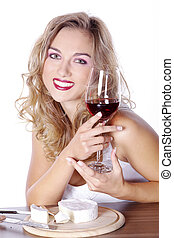 woman drinks wine during eating