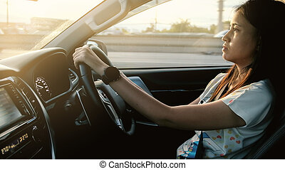 Woman drive a modern car on the road.