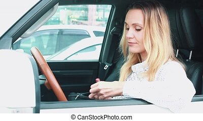 Woman driver doing makeup