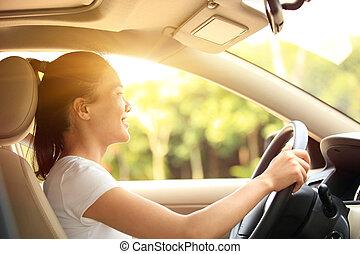 woman driver driving a car