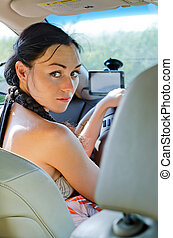 Woman driver looking back - Woman driver seated in the...