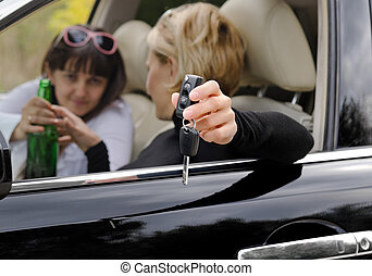 Woman driver reaching for a bottle of booze