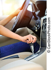 woman driver shifting gear stick