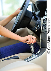 woman driver shifting the gear stic