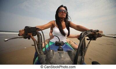 Woman Drives Quad At Beach