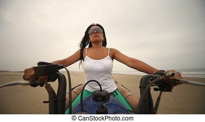 Woman Drives Quad